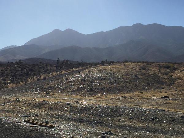 Shotgun shell casings and broken glass litter part of Nalen's patrol area in the Nevada desert.
