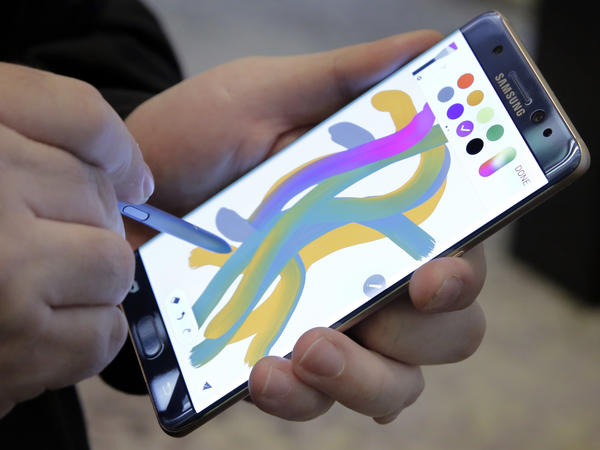Samsung's Galaxy Note 7 is demonstrated in New York on July 28. All owners of the new smartphone have been urged to exchange the device after reports of phones' exploding or catching fire.