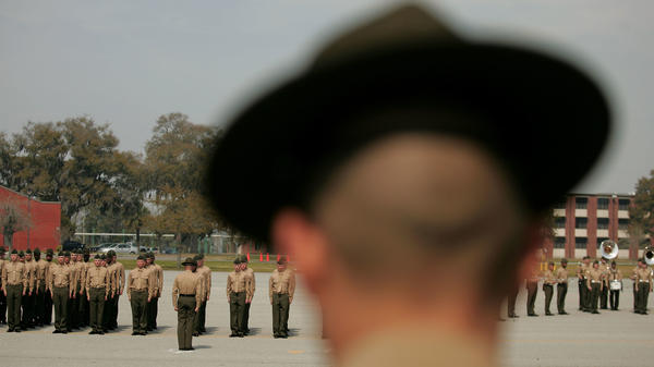 A Marine Corps drill instructor watches recruits on the parade deck during boot camp at Parris Island, S.C., in 2007.