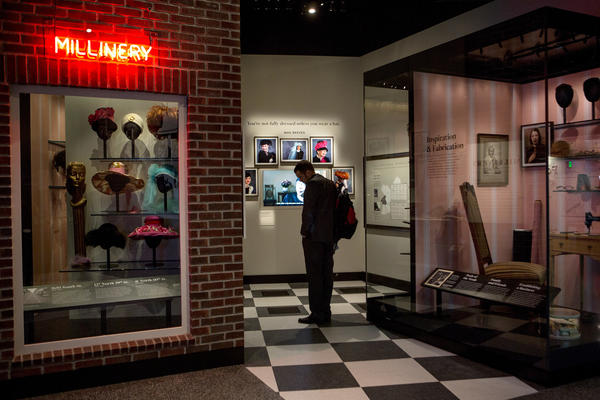 A visitor views a partial recreation of Mae's Millinery, a Philadelphia hat shop that once served Ella Fitzgerald and Lena Horne, at the National Museum of African American History and Culture.