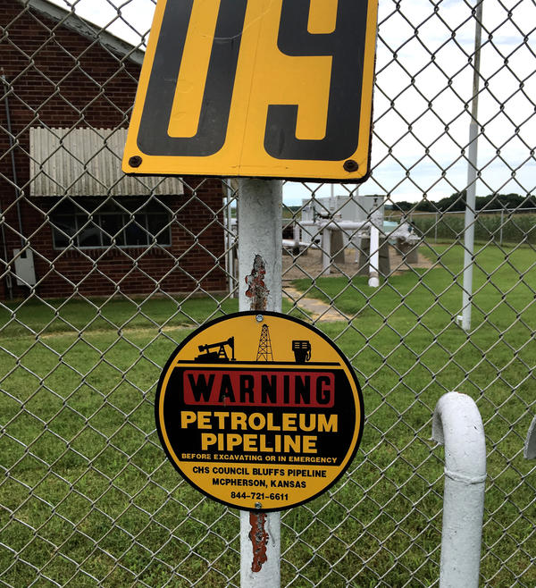 Pipelines snake underground through much of middle America, marked by small signs like this one.