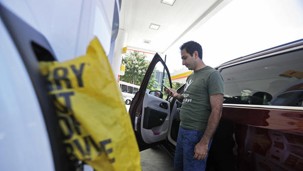 """A motorist who found an Atlanta gas station had run out of fuel calls a nearby gas station Monday to see if they have any left. Gas prices spiked and drivers found """"out of service"""" bags covering pumps as the gas shortage in the South rolled into the work week, raising fears that the disruptions could become more widespread."""