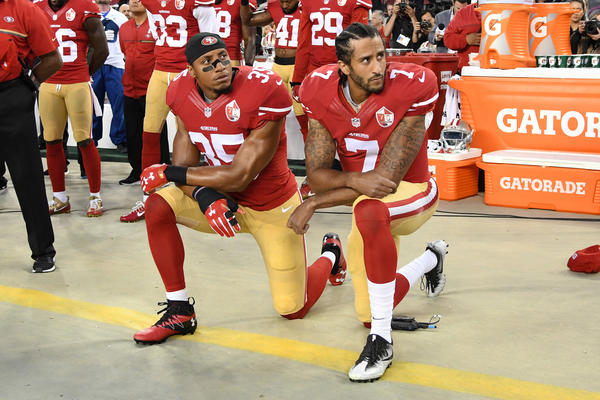 Eric Reid (left) and Colin Kaepernick of the San Francisco 49ers kneel in protest during the national anthem prior to playing the Los Angeles Rams at Levi's Stadium on Sept. 12.