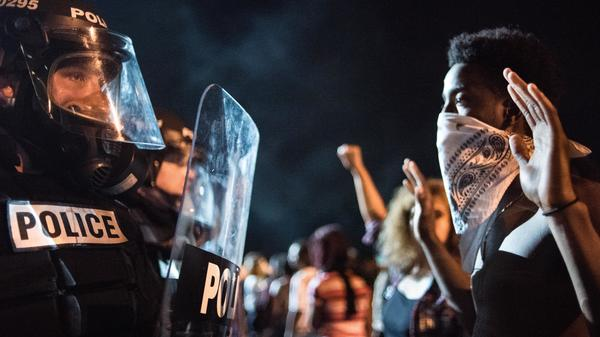 Police officers face off with protesters on Interstate 85 in Charlotte, N.C., during demonstrations following the death of a man shot by a police officer on Tuesday.