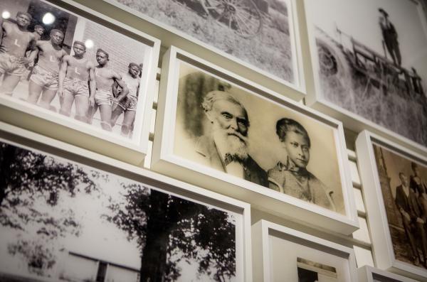 "Photographs of members of the Lyles Station community adorn the walls of the exhibit in the ""Power of Place"" gallery at the NMAAHC."