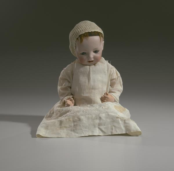 A doll owned by Clementine Roundtree Cottee and Josephine English Church, circa 1920.