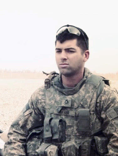 Mayer in Iraq in 2010, where he served as a sniper and was injured in a roadside explosion.