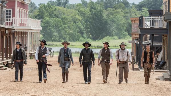 The updated, multicultural gang of gunslingers in <em>The Magnificent Seven.</em>
