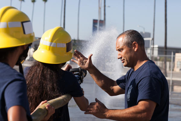 LAFD Capt. Eddie Marez instructs cadets at Banning High on how to operate a fire hose.