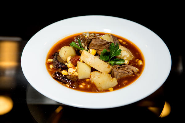 """Son of a Gun Stew"" — a cowboy classic that gets a modern twist with braised short ribs. It harkens back to the time when freed slaves moved to the Old West after the Civil War."