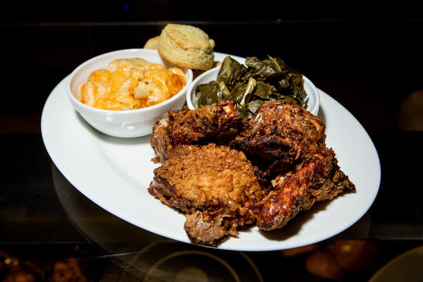"The ""Gospel Bird"" family platter, offered in the Agricultural South, comes with what many people consider soul food: mac and cheese, buttermilk fried chicken, collard greens and buttermilk biscuit."
