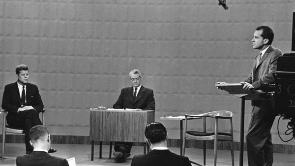 Vice President Richard Nixon speaks at the first general election presidential debate as Sen. John F. Kennedy listens on Sept. 26, 1960. Sitting in the center is moderator Howard K. Smith.