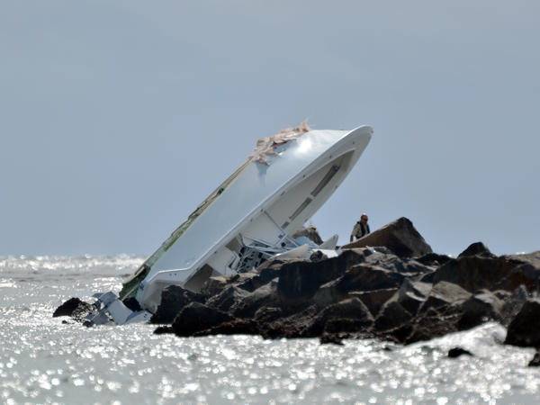 An image from Sunday morning of the boat that crashed into a jetty off Miami Beach, killing three people including Miami Marlins pitcher José Fernández.