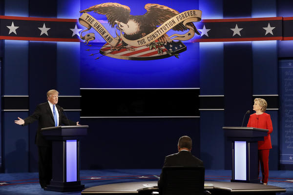 Republican presidential nominee Donald Trump answers a question as Democratic presidential nominee Hillary Clinton listens during the presidential debate at Hofstra University on Sept. 26, 2016.