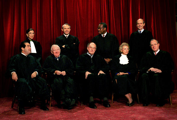 Justices of the U.S. Supreme Court pose for a group portrait in 1994 (from left, front): Associate Justices Antonin Scalia and John Paul Stevens, Chief Justice William Rehnquist, Associate Justices Sandra Day O'Connor and Anthony Kennedy; (from left, back) Associate Justices Ruth Bader Ginsburg, David Souter, Clarence Thomas and Stephen Breyer.