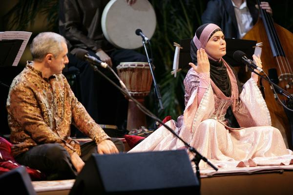 """Performers Alim Qasimov (left) and Fargana Qasimova on stage during a 2008 performance of """"Layla and Majnun"""" in Doha, Qatar. (Courtesy Silkroad)"""