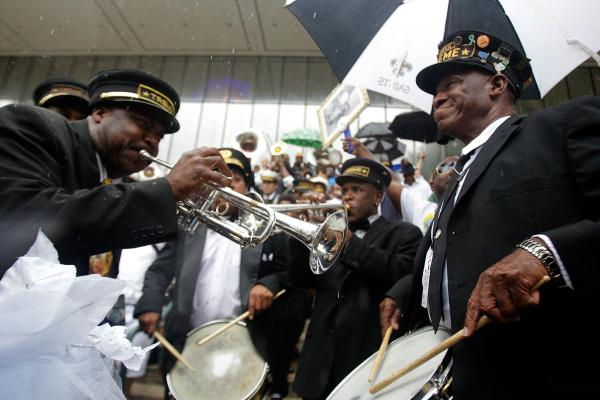 Members of the Treme Brass Band play a jazz funeral for their bass drummer, Lionel Batiste, in New Orleans.