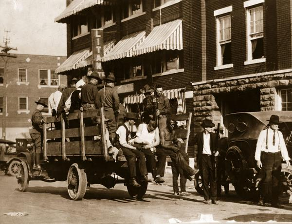 Injured and wounded prisoners are taken to hospital by National Guardsmen after martial law was declared in Tulsa, Okla., after the race riots in June 1921. (Hulton Archive/Getty Images)