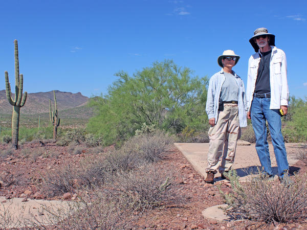 """Owen (left) and Penson stand on marker """"Y57,"""" located at the southwestern edge of a massive 289-square-mile grid of concrete X's."""