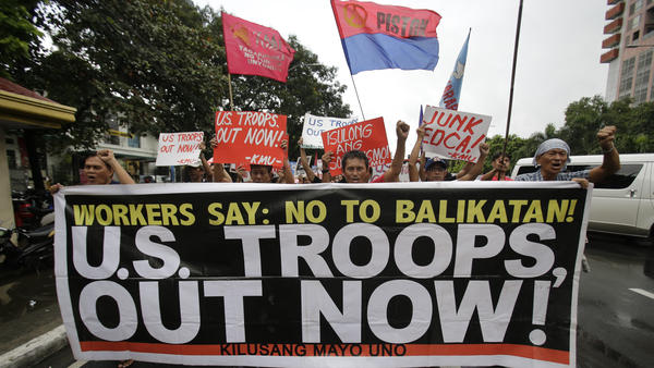Filipino activists rally against U.S.-Philippine military exercises in a protest Tuesday outside the U.S. Embassy in Manila.