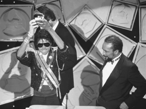 Michael Jackson, left, holds up his Grammy for Best Album of the Year as Quincy Jones looks on, in 1984. Rod Temperton wrote three of the hit songs for Jackson's smash album <em>Thriller</em>.