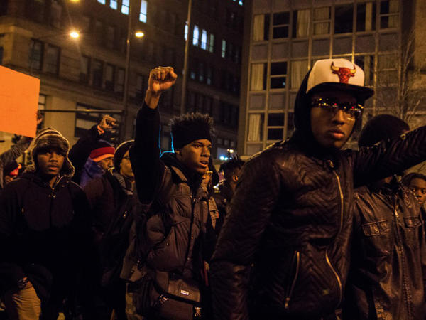 Demonstrators in Chicago march down Michigan Avenue on Nov. 25, 2015 in response to the release of a video showing Chicago Police officer Jason Van Dyke shooting and killing 17-year-old Laquan McDonald.