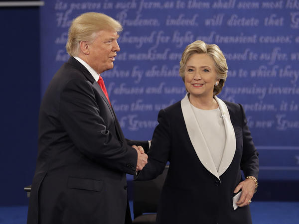 Republican presidential nominee Donald Trump shakes hands with Democratic presidential nominee Hillary Clinton at the end of the second presidential debate at Washington University in St. Louis, Monday night.