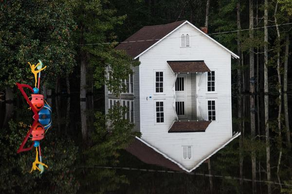 A building is inundated with floodwaters in Lumberton on Monday. Record floodwaters were rising in some areas of North Carolina.
