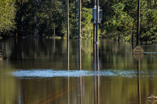 A street in Lumberton, N.C., was flooded on Monday. Torrential rains are continuing to fuel floods, days after Hurricane Matthew barreled up the U.S. coast and then headed out to sea.
