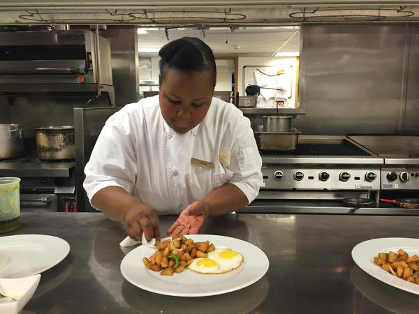 Florance Eloi preps a dish at Hilton's Conrad Miami. Eloi received 10 weeks' paid leave when she had her baby. The Labor Department says only 13 percent of workers in the private sector — and even fewer among hourly workers — have paid parental leave.