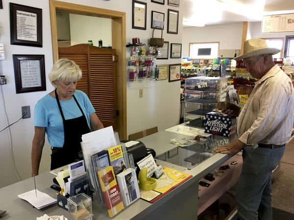 Linda Gainer, owner of the Narrows Café and RV Park near the Malheur National Wildlife Refuge, attends to a customer in June. She hopes the visitor center at Malheur reopens soon, for both the tourists' sake as well as the community.