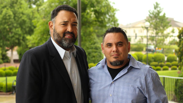 Judge Lou Olivera (left) with retired Green Beret Joe Serna outside the Cumberland County Courthouse in Fayetteville, N.C.