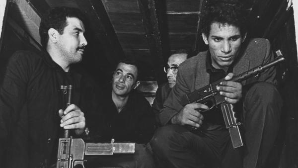 Saadi Yacef, as revolutionary leader El-hadi Jaffar (second from left) and Brahim Haggiag (right) as revolutionary leader Ali La Pointe in a scene from Gillo Pontecorvo's <em>The Battle Of Algiers</em>.