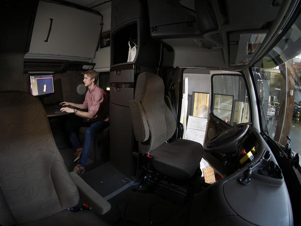 Don Burnette, senior staff engineer at Otto, checks the software on a computer in the back of the self-driving, big-rig truck. Self-driving trucks could make the lives of truckers safer and less stressful.