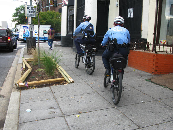 Police officers ride their bicycles in Washington, D.C. Sidewalk cycling is legal almost everywhere in the city, with the exception of the central business district.