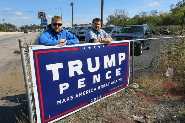 Adam Miller, 28, and Robert Miller, 32, placed a 4-by-8 Trump campaign sign on their family's used car lot in Dillsburg, Pa. The two men say they feel disenfranchised in a country that is becoming more diverse. Both say they believe their lives will be better if Donald Trump is elected instead of Hillary Clinton.