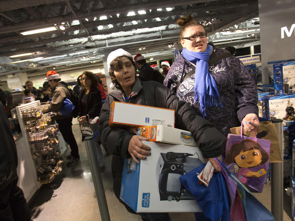 "People line up to purchase items at the ""Black Thursday"" sale at the Toys 'R Us store in Times Square on Nov. 22, 2012, in New York City. The store got a head start on the traditional Black Friday sales by opening their doors at 8 p.m. on Thanksgiving night."