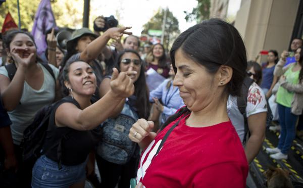 Demonstrators in favor of abortion rights (left) shout at an anti-abortion activist at a rally in Santiago, Chile, on March 21. Chile is one of the few countries that ban abortion in all circumstances. Lawmakers are working on a measure that would allow abortions in some cases. But many religious conservatives say the current law should remain.