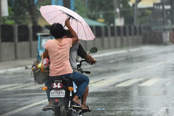 People in Manila flee as Super Typhoon Haima moved toward the Philippines on Wednesday.