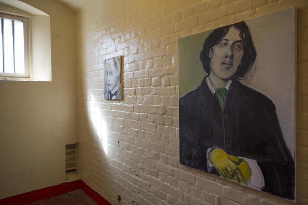 A painting of Wilde hangs inside a cell at the former Reading Prison. In 1895, Wilde was convicted of homosexual activity and sentenced to serve two years.