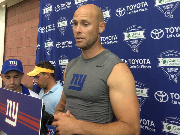 New York Giants' Josh Brown speaks with reporters at NFL football training camp in East Rutherford, N.J., last August.