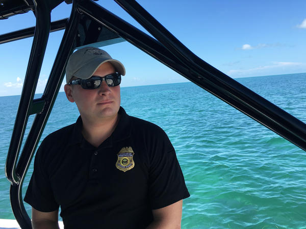 "John Apollony is a marine interdiction agent with U.S. Customs and Border Protection. ""They don't want us coming near them, and they're gonna do everything to get their vessel to shore,"" he says of the Cuban migrants."