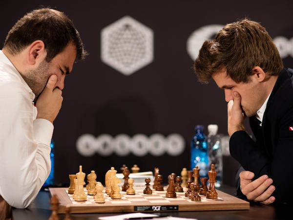 World chess champion Magnes Carlsen (right) won't play his computer or play the game like a computer. Instead, he chooses his strategy based on what he knows about his opponent.