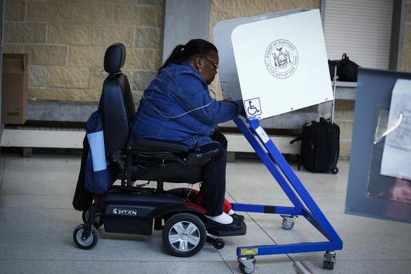 A woman casts her vote at a polling station in Brooklyn in the New York state presidential primary on April 19.