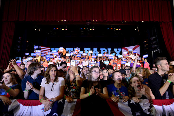Crowds cheer as U.S. Rep. Patrick Murphy, D-Fla., who is running to unseat Sen. Marco Rubio, speaks Tuesday at a rally with Hillary Clinton at Omni Auditorium, Broward College North Campus, in Coconut Creek, Fla. The event highlighted the start of in-person early voting in the state.