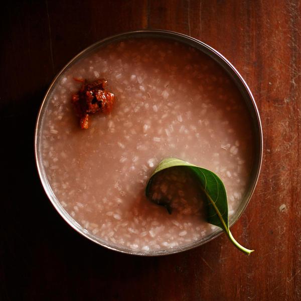 Kerala-style <em>kanji,</em> a South Indian rice porridge, served with a jackfruit leaf as a spoon.