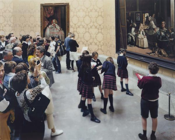 """Thomas Struth is known for large photographs of people looking at paintings, sculptures and art in museums. In <em>Museo del Prado 7, Madrid 2005</em>, a school group sketches Diego Velazquez's <a href=""""https://upload.wikimedia.org/wikipedia/commons/9/99/Las_Meninas_01.jpg"""">Las Meninas</a>."""