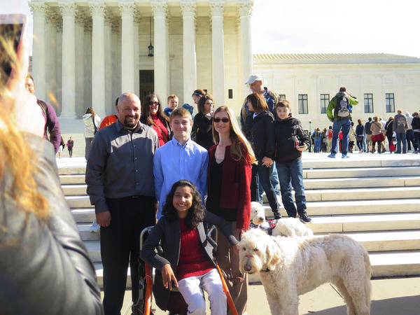 Ehlena Fry and her service dog, Wonder, visit the Supreme Court on Monday.