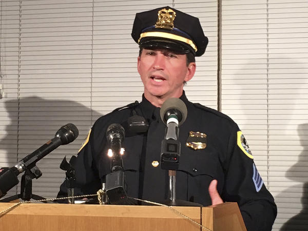 Des Moines Police Sgt. Paul Parizek speaks to reporters Wednesday. Authorities say two police officers in the Des Moines, Iowa, area were shot to death in ambush-style attacks about three miles apart.