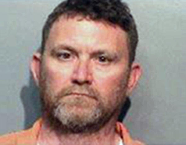 This undated photo provided by the Des Moines Police Department shows Scott Michael Greene, of Urbandale, Iowa. Des Moines and Urbandale Police said in a statement Wednesday that they have identified Greene as a suspect in the killings early Wednesday morning of two Des Moines area police officers.